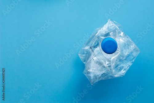 Fotografia, Obraz  Used plastic bottles crushed and crumpled against on the blue background