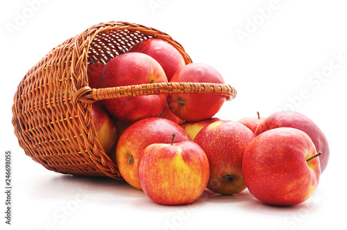 Red apples dropped out of the basket. Fototapet