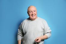 Portrait Of Elderly Man On Color Background