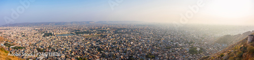 Deurstickers Asia land Panoramic beautiful sunset view from Nahargarh Fort stands on the edge of the Aravalli Hills, overlooking the city of Jaipur in the Indian state of Rajasthan, India.