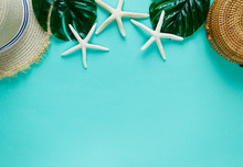 Tropic Flat Lay With Straw Hat, Bag, Starfish, Shells, Leaf On Pastel Green Background. Summer Creative Fashion Flat Lay, Vacation, Travel Concept. Top View With Copy Space.