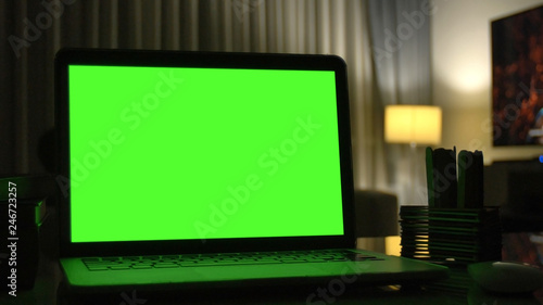 Laptop with green screen for replacement with blur background - 246723257