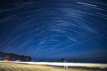 Star Trail At The Beach With Figure