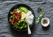 Rice Bowl With Spicy Beans Minced Meat Stew With Cilantro And Avocado On Grey Background, Top View
