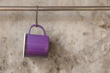 Violet Tin Cup Hanging On Stai...