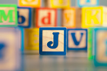 Photograph Of Colorful Wooden Block Letter J