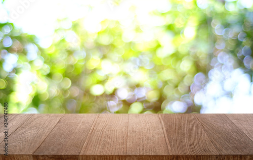 Tuinposter Purper Empty dark wooden table in front of abstract blurred bokeh background of restaurant . can be used for display or montage your products.Mock up for space.