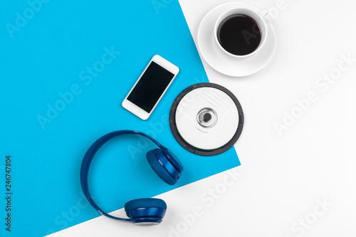 Fototapeta Blue headphones on blue and white color background obraz na płótnie