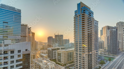 Fototapety, obrazy: Aerial view of Dubai Marina from a vantage point at sunset timelapse.
