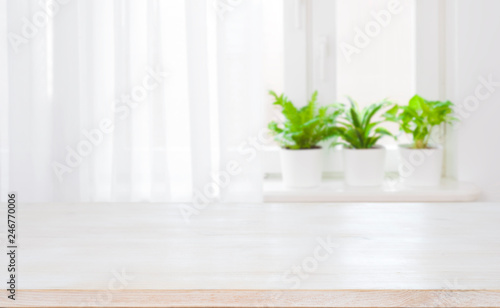 Fotografía  Empty top of wooden table on blurred curtained window background
