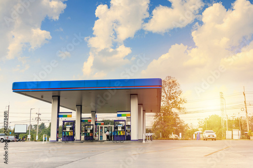 Fotografie, Obraz  Petrol gas fuel station with clouds and blue sky