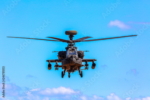 Fototapeta Fighting helicopter in military training Saber Strike in Latvia.