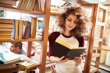 Female Read Book In Library