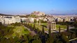 Aerial birds eye view video taken by drone of iconic pillars of temple of Zeus and Acropolis hill at the background, Athens historic center, Attica, Greece