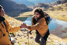 Helping Hand - Hiker Man Getti...