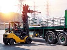 Forklift Handling White Sugar Bags Outside Warehouse For Stuffing Onto Truck.
