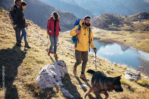 Tuinposter Grijs Group of hikers walking on a mountain at autumn day