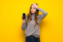 Young Woman Over Yellow Wall W...