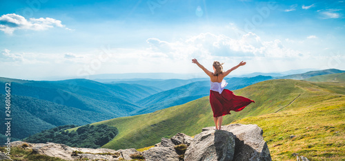 Obraz Young woman on the top of mountain - fototapety do salonu