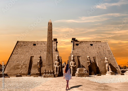 Wall Murals Place of worship Barefoot Woman at Entrance to Luxor Temple, a large Ancient Egyptian temple complex located on the east of the Nile River in the city today known as Luxor (ancient Thebes). Was consecrated to the god