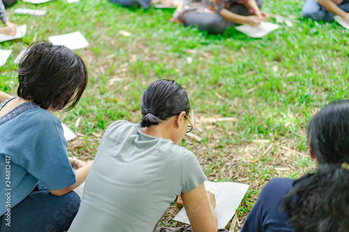 Valokuva  Asian guys in the garden workshop and have acted together.