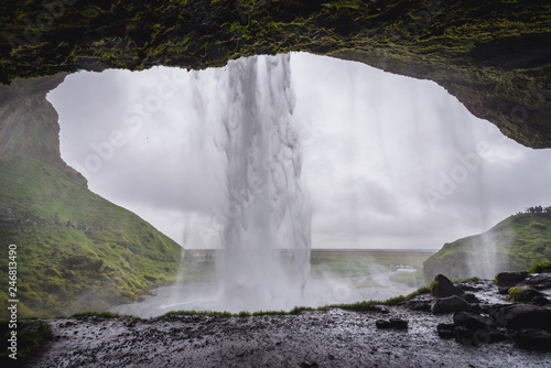 Foto auf Gartenposter Wasserfalle View from a small cave behind famous Seljalandsfoss waterfall in Iceland