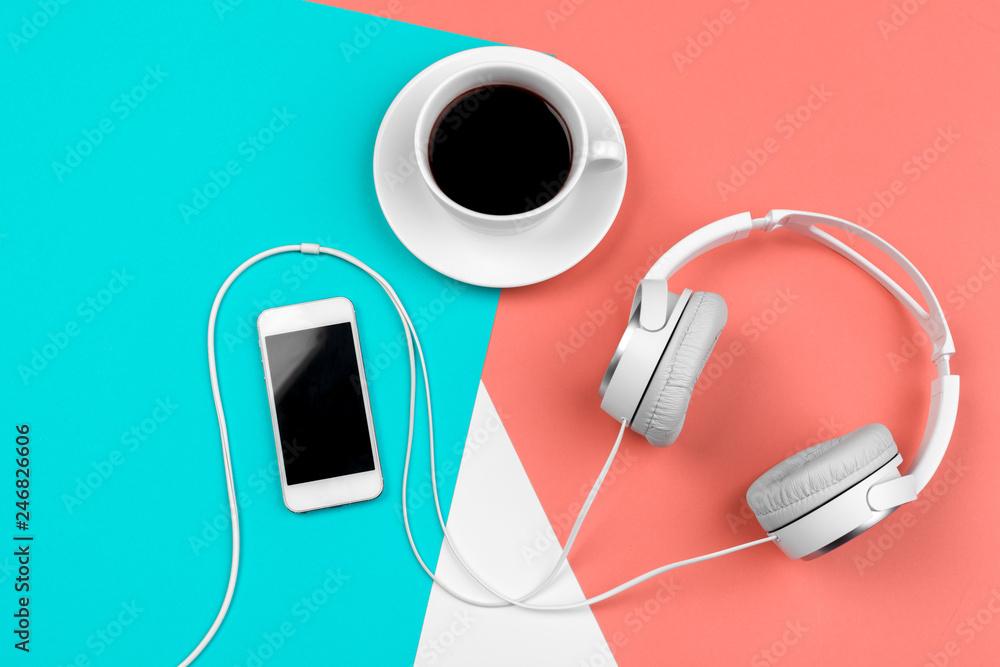 Fototapeta Headphones with cord on a bright color block background - obraz na płótnie