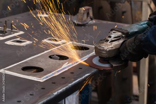 Obraz na płótnie Surface grinding on steel workpiece