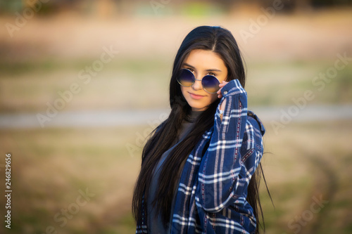 Fotografie, Obraz  Brunette girl smiling at camera wearing glasses