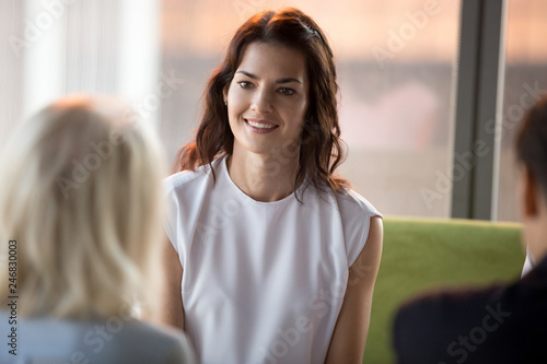 Confident happy millennial seeker applicant smiling looking at hr during job int Wallpaper Mural