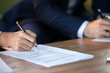 Leinwandbild Motiv Close up view of woman and man signing document concluding contract concept making prenuptial agreement visiting lawyer office, female and male partners or spouses writing signature on decree paper