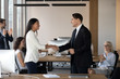 Boss shaking hand of asian employee congratulate successful worker with promotion, hiring intern, appreciate for good work while business team applaud support colleague, reward recognition concept