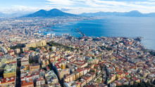 Aerial View Of Naples From The Vomero District. You Can See Castel Sant'elmo In The Foreground While In The Background The City's Port, The Vesuvius And The Ovo Castle. There Are Houses And Buildings.