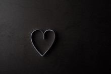 White Heart Shaped Paper In Shadow On Black Background