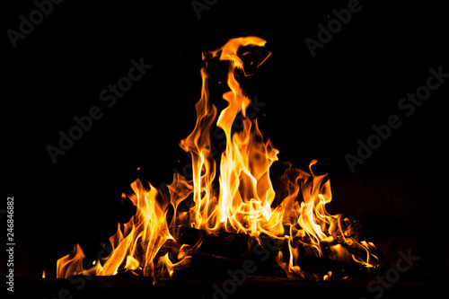 Photo Stands Fire / Flame Fire flames burning isolated on black background. High resolution wood fire flames collection smoke texture background concept image.
