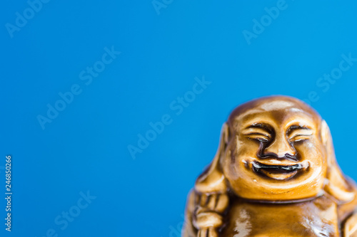 Generic Statue Of Laughing Buddha On Sky Blue Background Buddhism