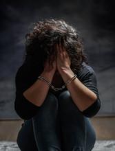 Women Handcuffed In Criminal Concept
