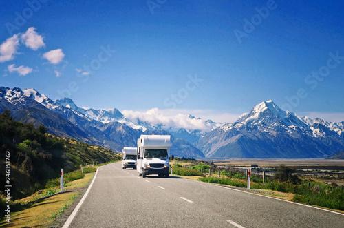 Obraz na płótnie Two white caravan cars on the way in New Zealand