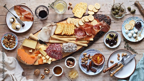Deurstickers Voorgerecht Appetizers table with various of cheese, curred meat, sausage, olives and nuts Festive family or party snack concept. Overhead view.