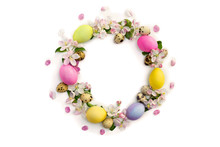 Easter Decoration. Circle Easter Frame Of Pink Flowers Apple Tree, Colored Easter Eggs And Quail Eggs On White Background With Space For Text. Top View, Flat Lay