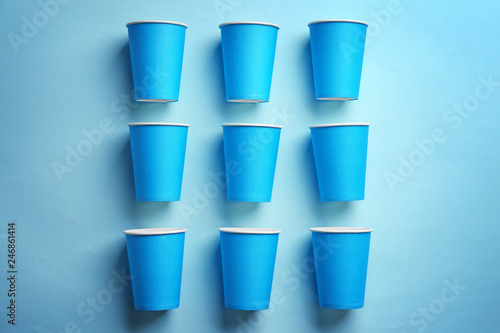 Flat lay composition with plastic cups on color background. Table setting