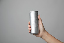 Woman Holding Aluminum Can Wit...