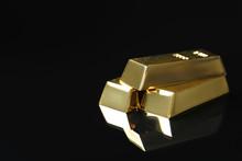 Shiny Gold Bars On Black Backg...