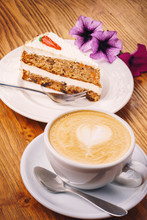 Cup Of Fresh Cappuccino Coffee With Delicious Piece Of Carrot Cake On The Wooden Table