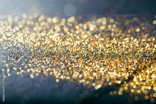 Obraz gold confetti on black background - fototapety do salonu
