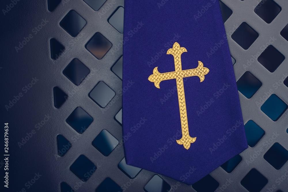 Fototapeta Purple fabric stole in confessional in church.