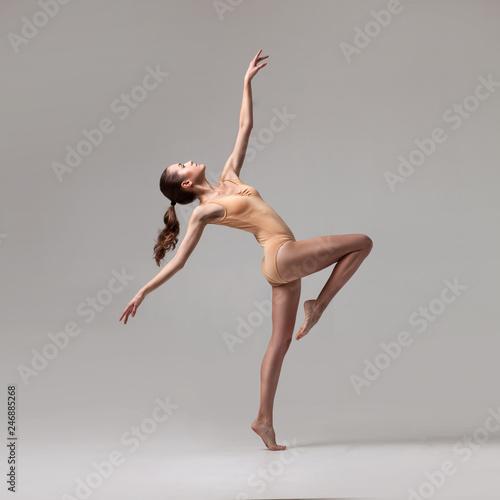 Fototapeta  young beautiful ballet dancer in beige swimsuit