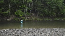 A Fisherwoman Fishes For Salmo...