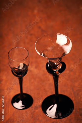 empty liquor cocktail glass wooden table