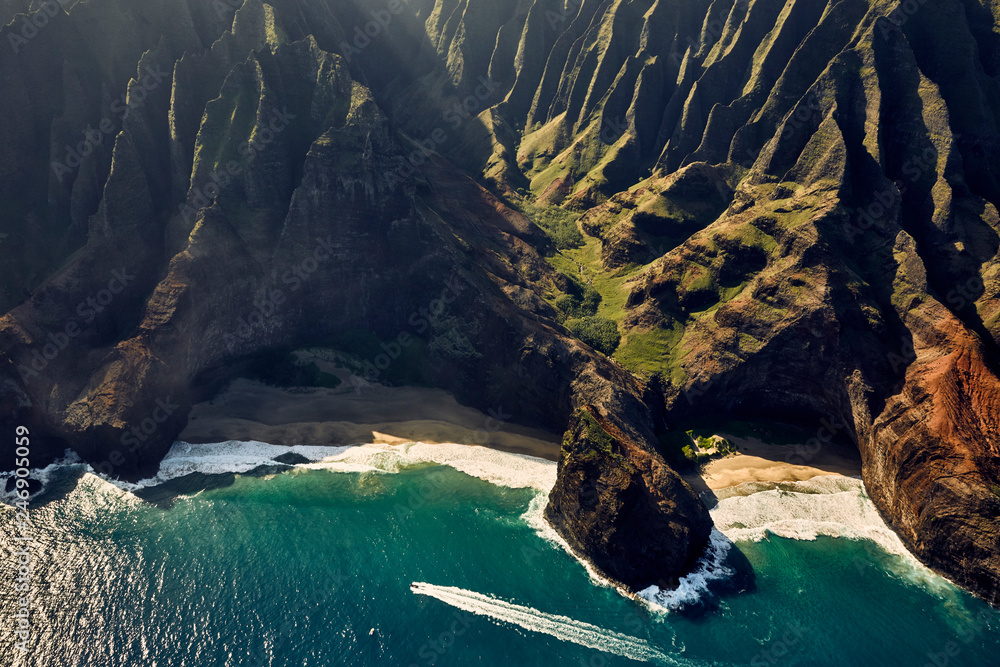 Aerial view of speedboat moving in cove, Hawaii
